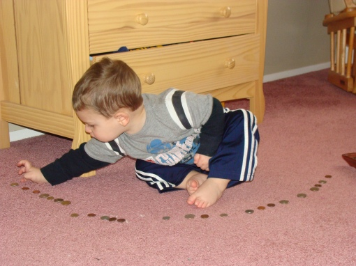 He lined up all of the coins and was so proud of himself :)
